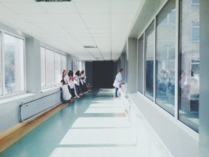 hospital workers waiting on a hallway