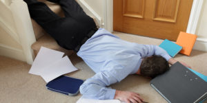 business men falling off the stairs at workplace