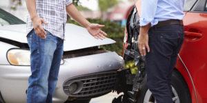Men discussing after a car crash